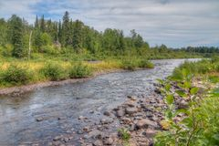 The Pigeon River flows through Grand Portage State Park and Indian Reservation. It is the Border between Ontario and Minnesota stock photos