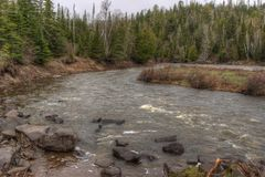 The Pigeon River flows through Grand Portage State Park and Indian Reservation. It is the Border between Ontario and Minnesota stock images