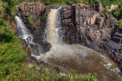 The Pigeon River flows through Grand Portage State Park and Indian Reservation. It is the Border between Ontario and Minnesota royalty free stock image