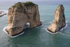 Pigeon Rocks. The famous Pigeon Rocks : geological landmarks that can be seen off the coast of Beirut (Lebanon Stock Photo