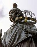Pigeon sitting on Copernicus head stock image