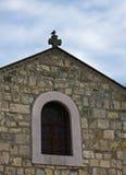 Pigeon sitting on a cross of a church at Kalemegdan fortress, Belgrade Stock Photo