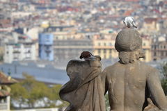 The pigeon and the statue Royalty Free Stock Images
