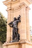 Pigeons on Black Statue. In Barcelona Spain royalty free stock photo