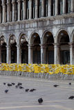 Pigeons and chairs on St. Marc Square Stock Photos