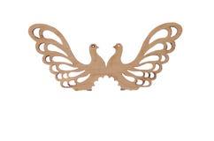 Pigeons en bois d'oiseau de souvenir sur un fond blanc Photographie stock