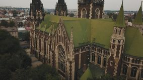 Pigeons fly from a gorgeous Gothic cathedral in the old European city.  stock video footage