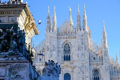 Pigeons and lion in font of Milan Duomo stock image