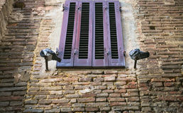pigeons near closed window of medieval house royalty free stock photography