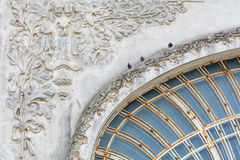 Pigeons on old city building. Three black pigeons are sitting on Royalty Free Stock Photos