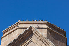 Pigeons Resting on Church Stock Photos