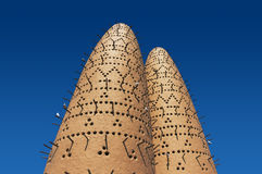 The pigeons sitting on poles of the birds towers in Katara Cultural Village, Doha, Qatar Stock Photography