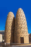 The pigeons sitting on poles of the birds towers in Katara Cultural Village, Doha, Qatar Stock Photos