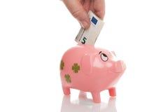 Pigg rosa dei soldi con l'euro Fotografie Stock