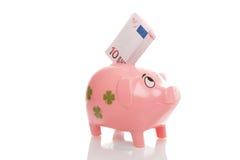 Pigg rosa dei soldi con l'euro Fotografie Stock Libere da Diritti