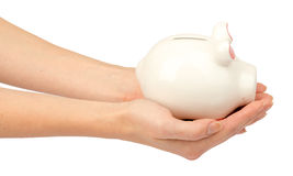 Pigggy bank in humans hands, side view Royalty Free Stock Images