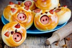 Piggies buns stuffed with sausage stock images