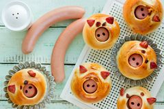 Piggies buns stuffed with sausage, homemade burger buns shaped funny pigs stock images