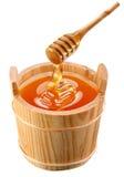 Piggin of honey and wooden stick. Stock Photo