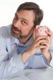 piggy συνεδρίαση επιχειρηματιών τραπεζών Στοκ εικόνα με δικαίωμα ελεύθερης χρήσης