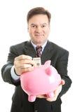 piggy бизнесмена банка счастливое сохраняет Стоковое Изображение RF