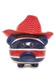 Βρετανική piggy τράπεζα που φορά το καπέλο κάουμποϋ Στοκ εικόνα με δικαίωμα ελεύθερης χρήσης