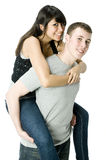 Piggy Back. A young couple in love having a piggyback ride Royalty Free Stock Photo