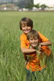 Piggy back. Happy smiling children playing piggyback Stock Image