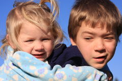 Piggy back ride 3. Older brother giving younger sister a piggy back ride royalty free stock photography