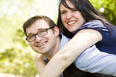 Piggy Back Rides Young Couple in the Park Stock Images