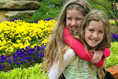 Piggy back twins royalty free stock photography