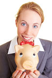 Piggy bank. Businesswoman holding a big piggy bank in her hands Royalty Free Stock Photo