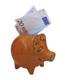 Piggy bank. Ceramic piggy bank with 20 euros note, isolated on white background Royalty Free Stock Photography