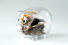 Piggy bank. A glassy piggy bank on white background Royalty Free Stock Photos