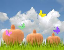 Piggy bank. With colorful butterflies Stock Photography