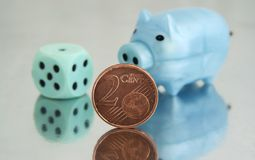 Piggy bank and 2 cents Royalty Free Stock Photo