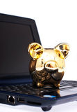 Piggy bank. On the laptop on white background Royalty Free Stock Images