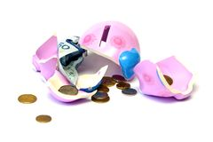 Piggy bank. Broken pig money box, coins and banknotes Royalty Free Stock Photo
