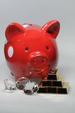 Piggy bank. The photo shows a piggy back six gold Barrend and three diamonds Royalty Free Stock Photo