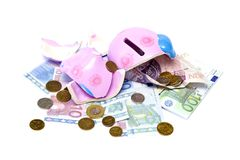Piggy bank. Broken pig money box, coins and banknotes Stock Photo