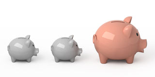 Piggy bank. One pink piggy bank and two gray Royalty Free Stock Photos