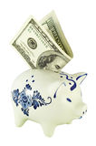 Piggy bank. And dollars in it isolated with clipping path Royalty Free Stock Image