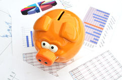 Piggy bank. On a financial report Royalty Free Stock Image