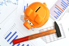 Piggy bank. On a financial report Stock Images