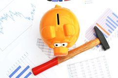 Piggy bank. On a financial report Royalty Free Stock Photo