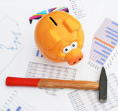 Piggy bank. On a financial report Stock Photography