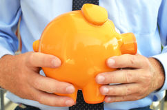 Piggy bank. In the hands Royalty Free Stock Image