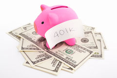 Piggy bank 401K and dollar Stock Photos
