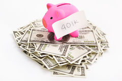 Piggy bank 401K and dollar Stock Image