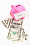 Piggy bank 401K and dollar Stock Images